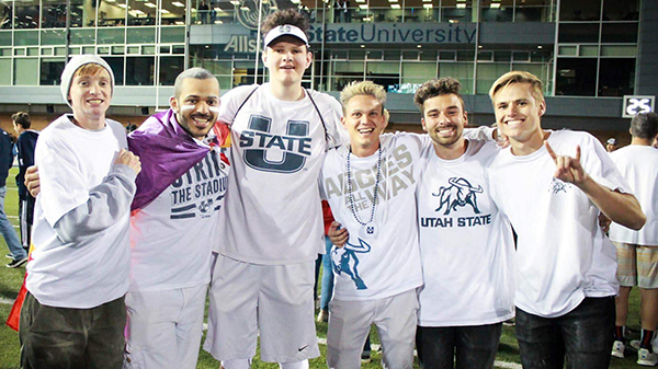 Fraternity members at Utah State University celebrate after a flag football tournament.