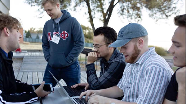Members of fraternities at Utah State University work together at a leadership retreat.