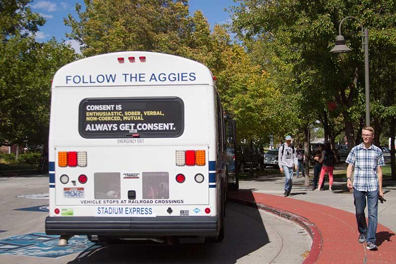 Consent promotion on the back of an Aggie Shuttle.