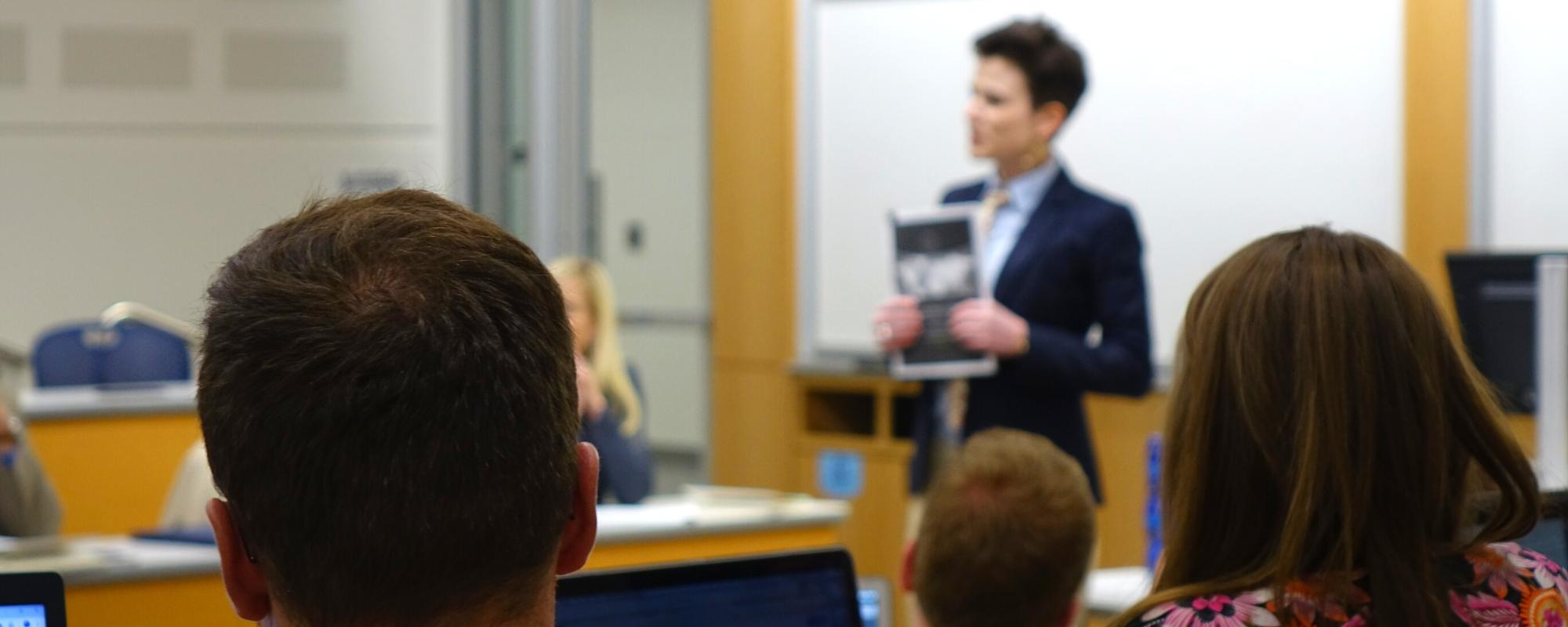 An instructor discusses the 2019 Worldwide Threat Assessment with Center for Anticipatory Intelligence students.