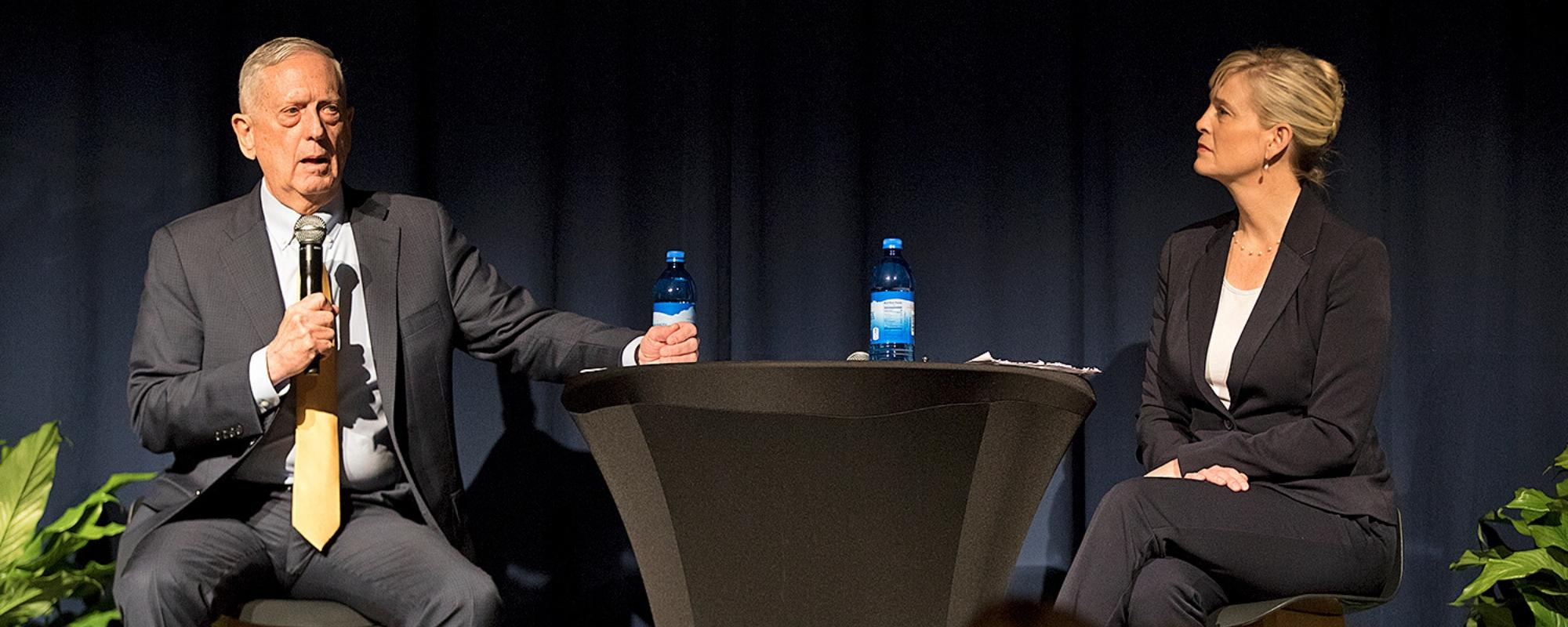 Former Secretary of Defense Jim Mattis and CAI Director Jeannie Johnson discuss a question during a convocation on the USU campus.