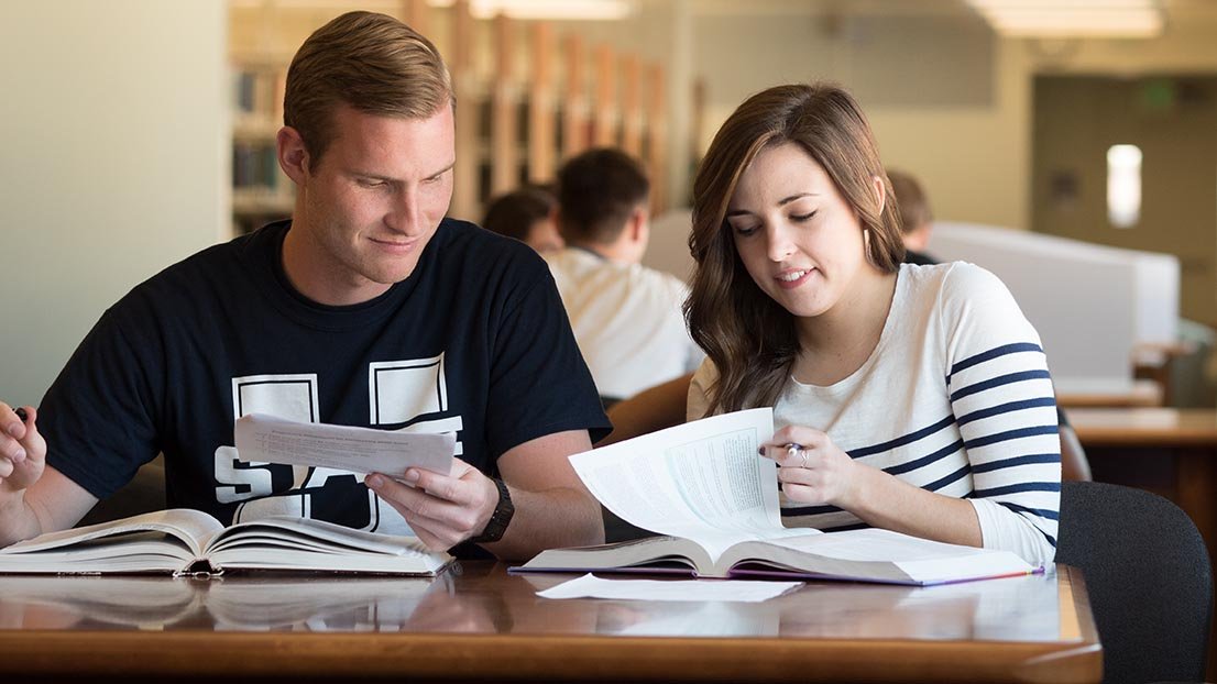 USU Students Studying in the library