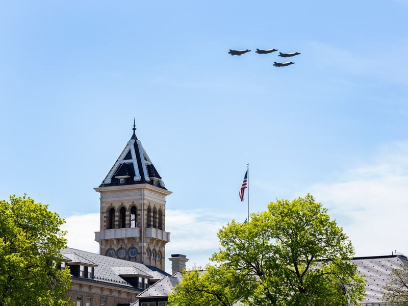 Four F-35 fighter jets fly past Old Main