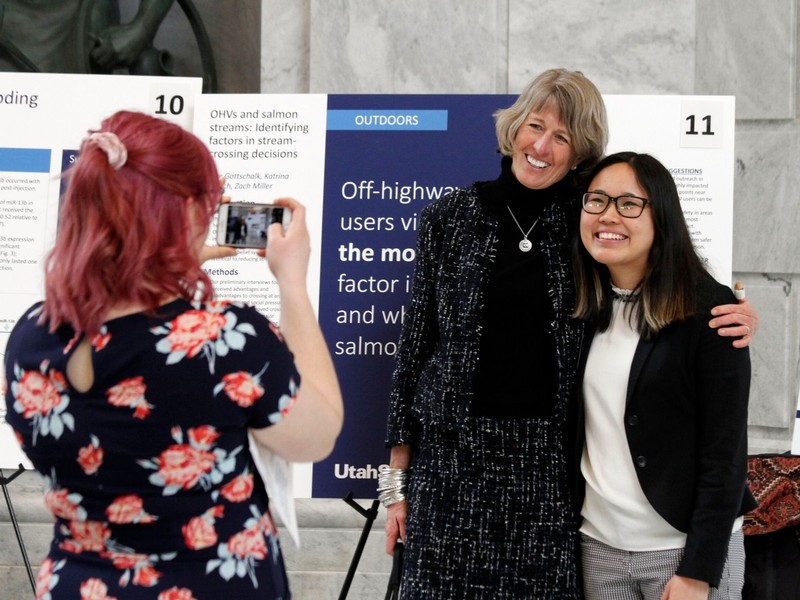 USU President Noelle Cockett Poses for a photo with a student researcher at the Utah State Capitol.