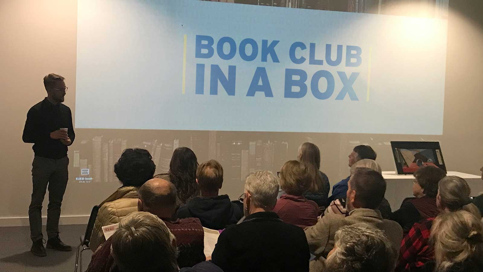 "Guest lecturer presents during a 2018 ""Book Club in a Box"" event."