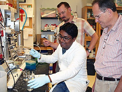USU biochemists perform lab tasks