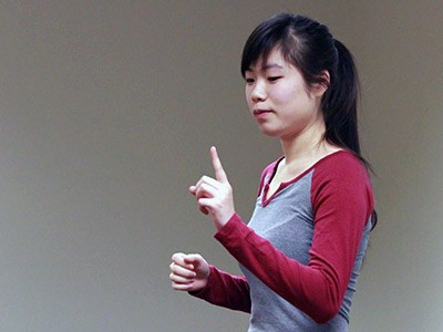 an American Sign Language student at USU practicing the language