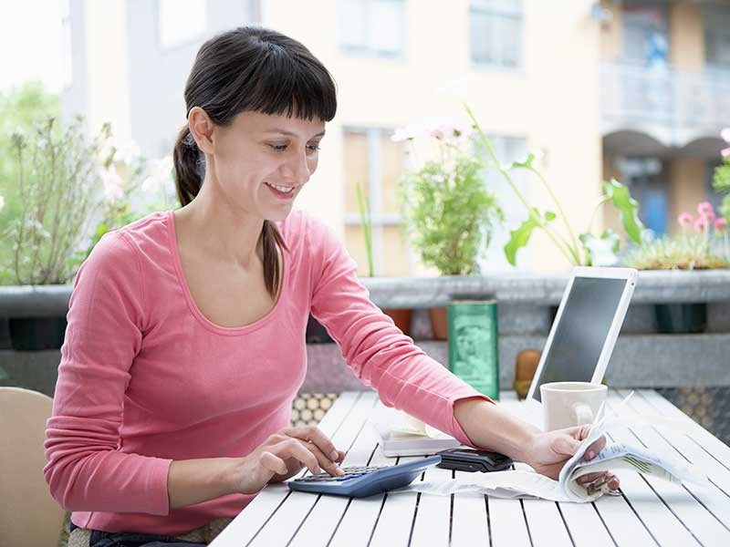 woman with calculator and receipts