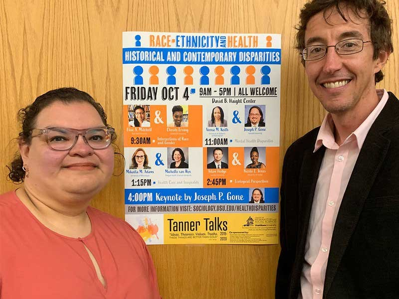 Guadalupe Marquez-Velarde and Seth Archer with poster about their day-long seminar.