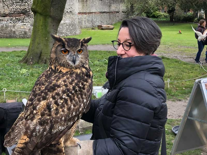 Professor Laura Gelfand with Henrietta the Owl at York Museum Gardens