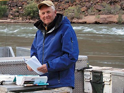 USU professor and researcher Jack Schmidt doing fieldwork research on a river