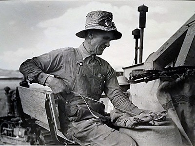 USU Museum exhibit, photograph of a Mormon farmer bagging wheat
