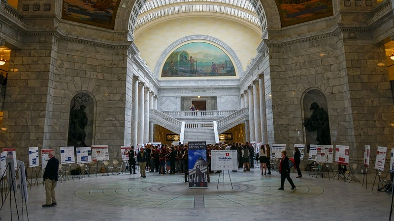 Undergrad researchers showcasing research at the Utah Capitol Rotunda.
