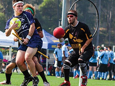 Members of the USU Quidditch team on the field