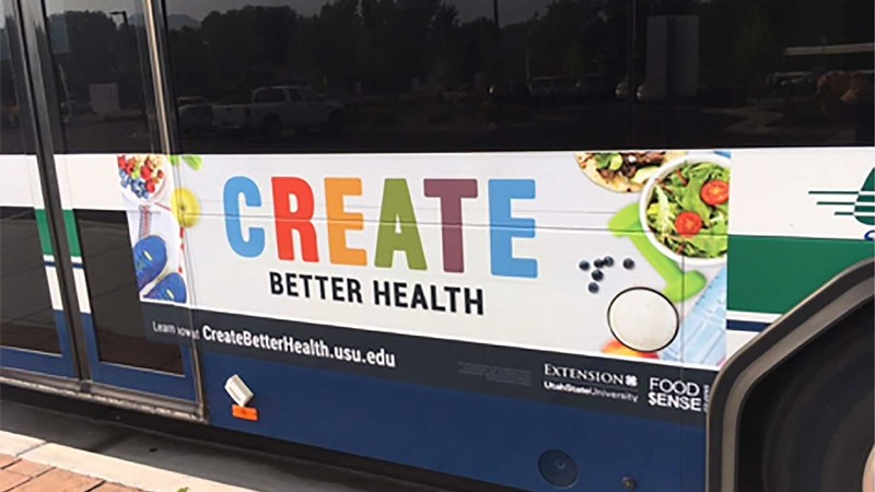 Create Better Health billboard on the side of a bus.