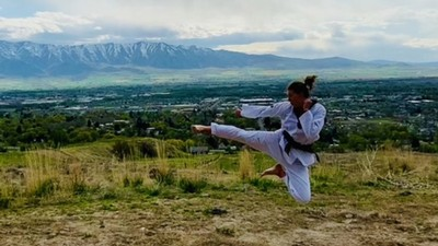 Student performs flying side kick.