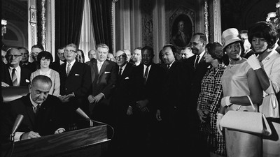 U.S. President Lyndon B. Johnson signing the Voting Rights Act of 1965 on August 6, 2965.