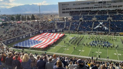 large flag is presented in USU's Maverik Stadium.
