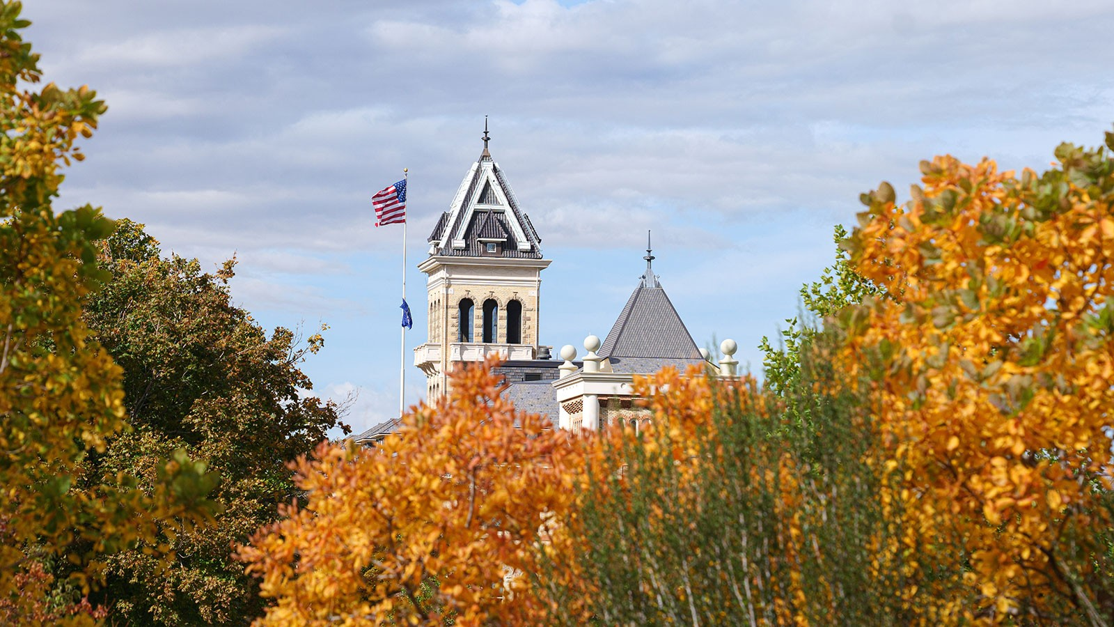 Old Main with fall leaves in the background.
