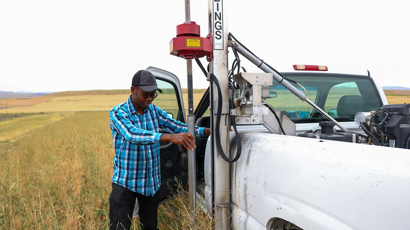 Idowu Atoloye looking over equipment while out in the field.