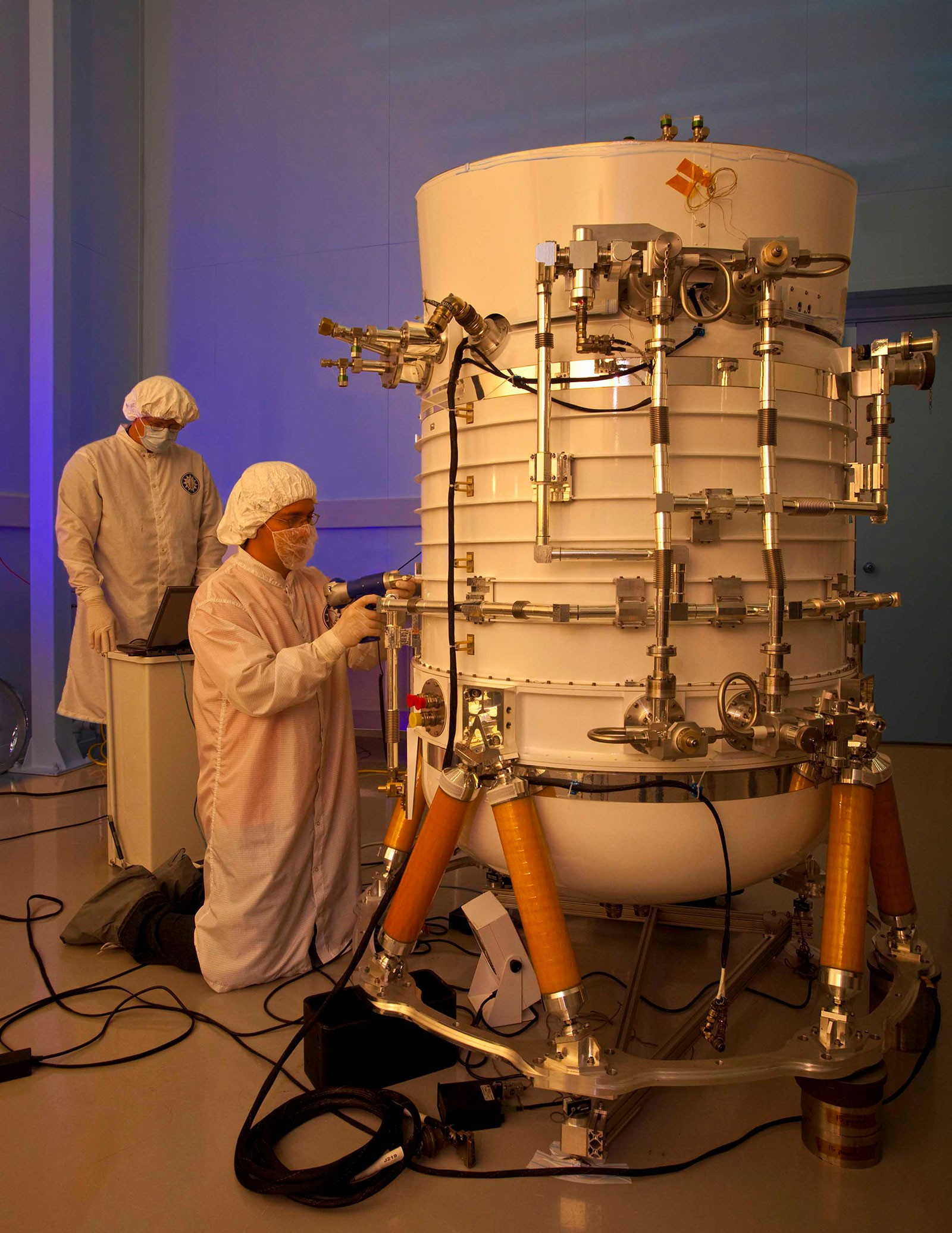 In this 2009 photograph, SDL engineers prepare the Wide-field Infrared Survey Explorer telescope.