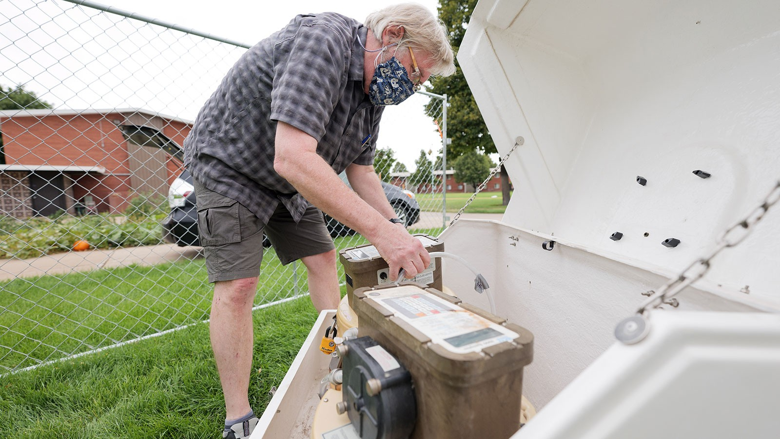 Professor Ryan Dupont sets up waste water collection apparatus