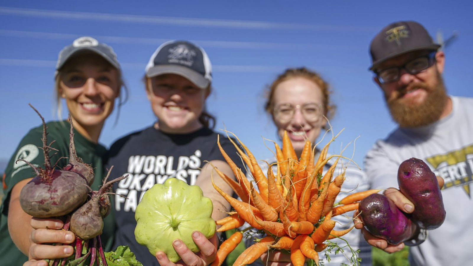 USU dietetics students holding vegetables.