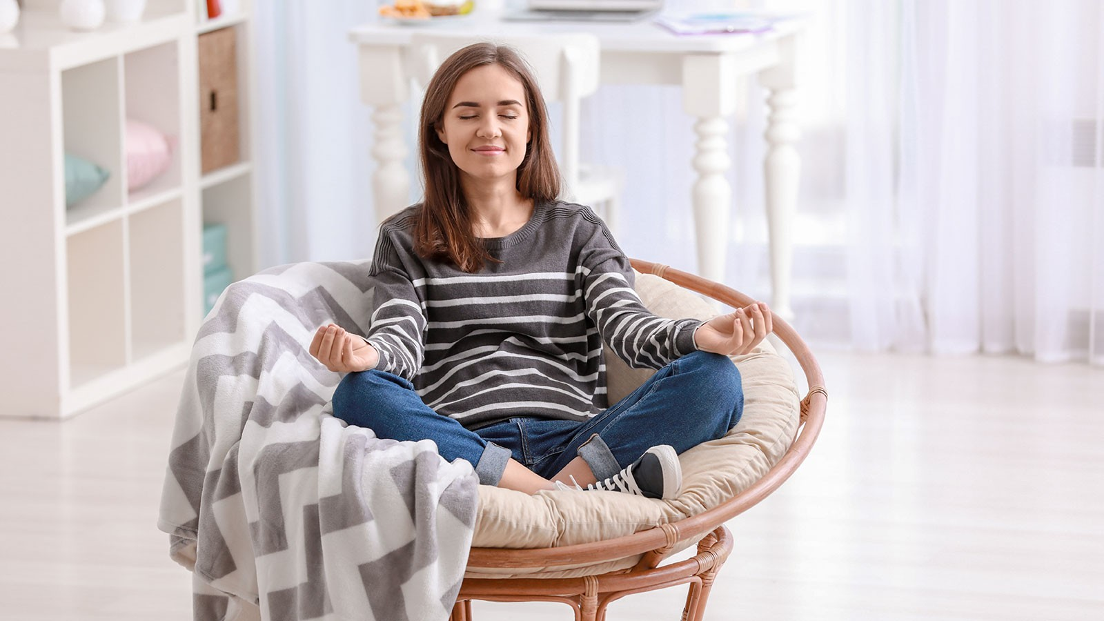 woman meditating in a chair.