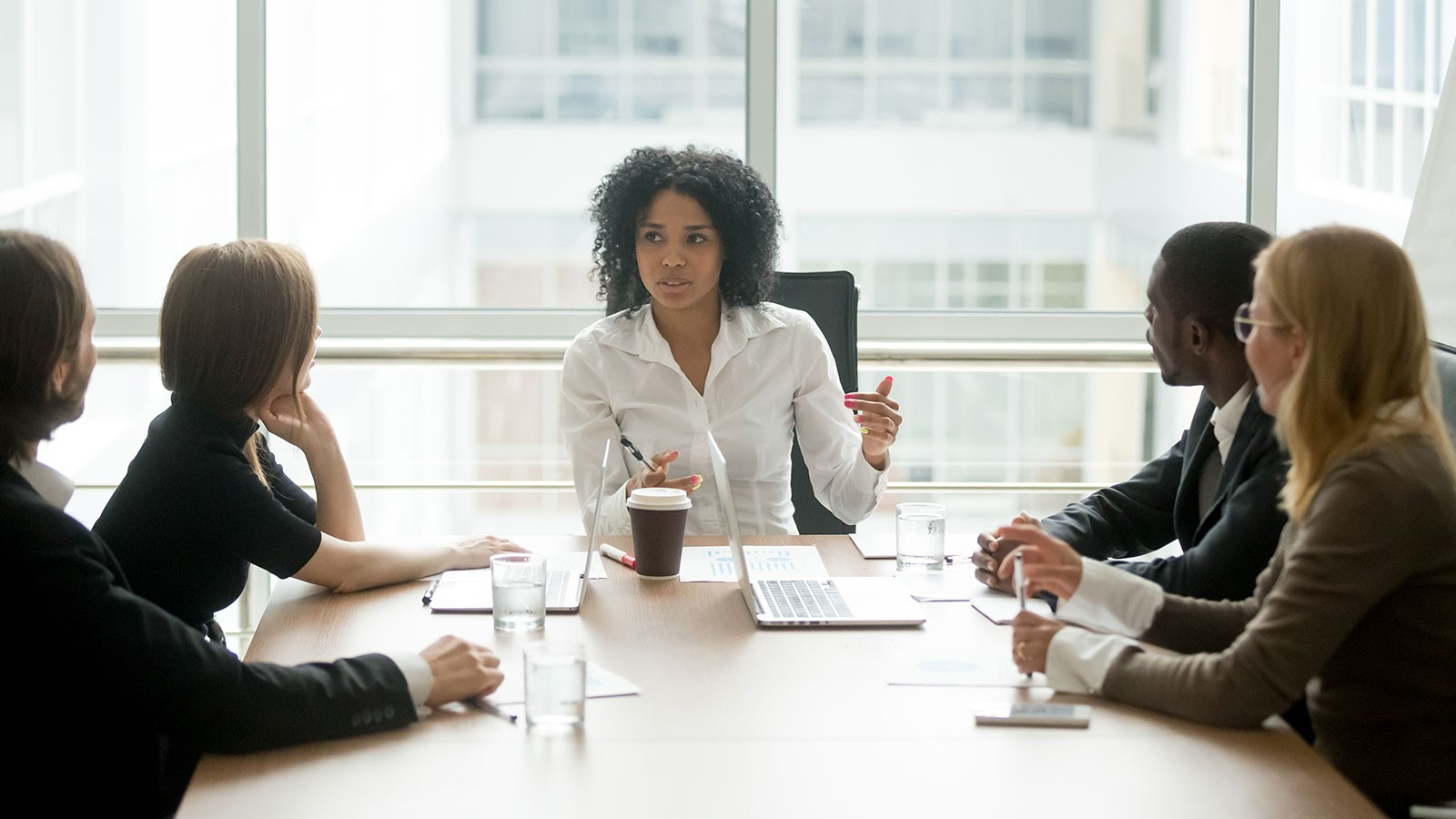 woman leading a meeting in a conference room.