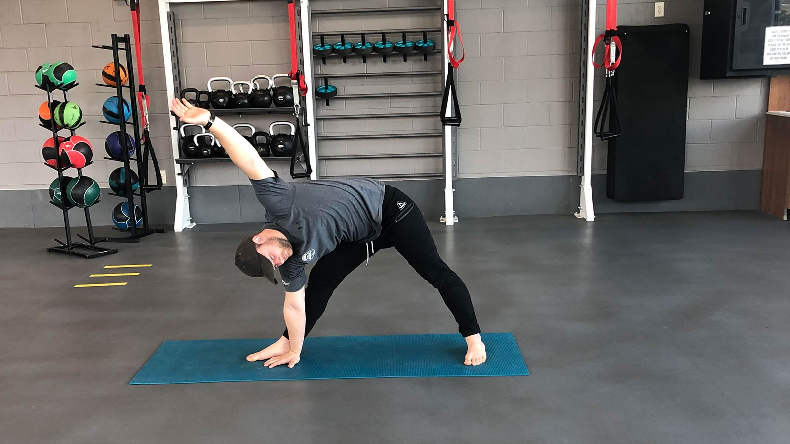 trainer doing a workout move.