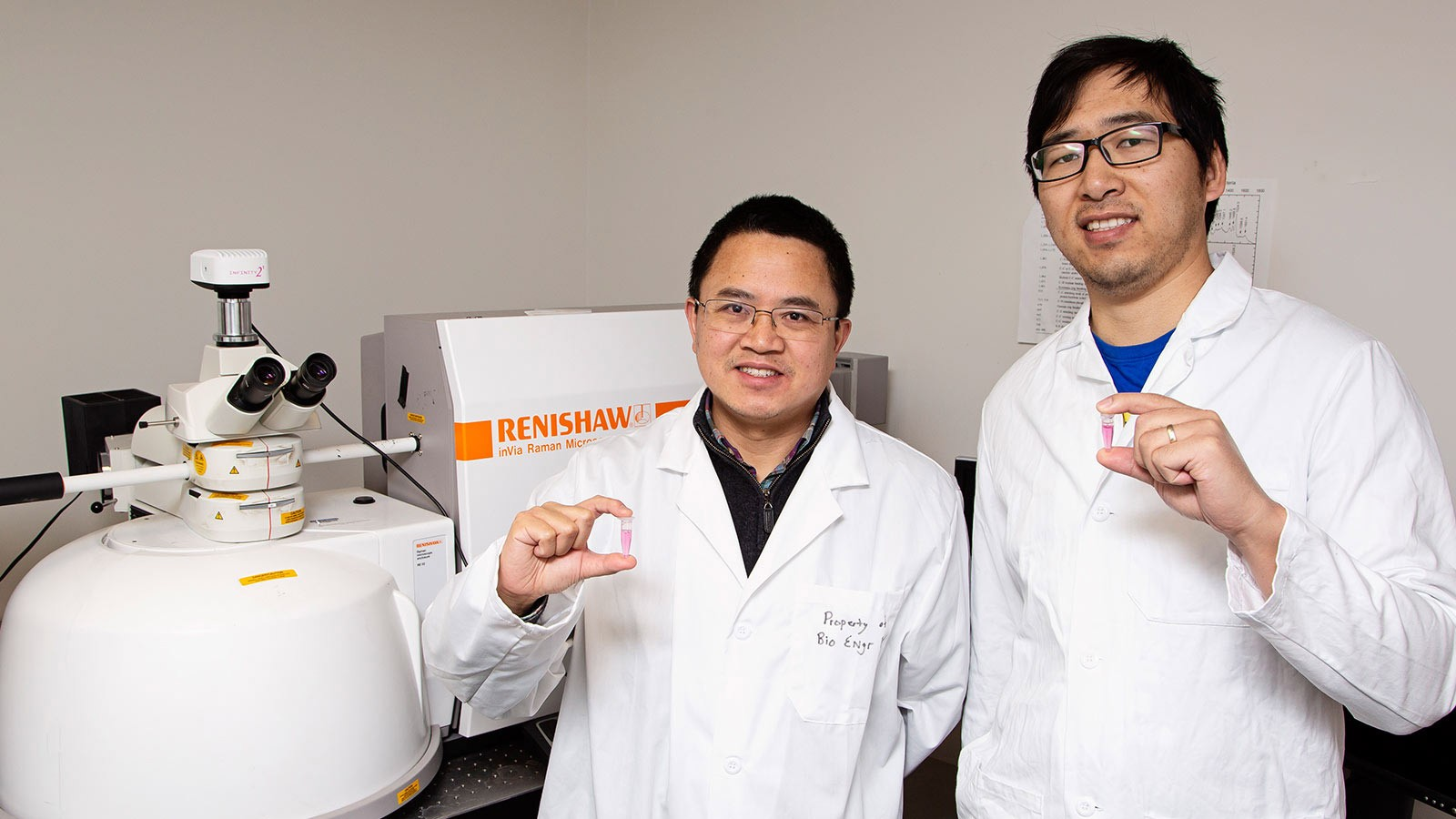 Professor of biological engineering Anhong Zhou and PhD student Wei Zhang