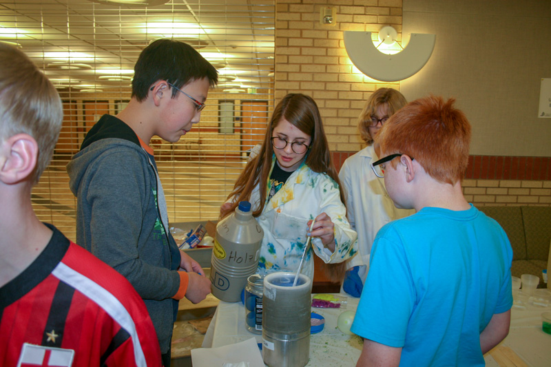 Chemistry students demonstrating a reaction at USU's Science Unwrapped