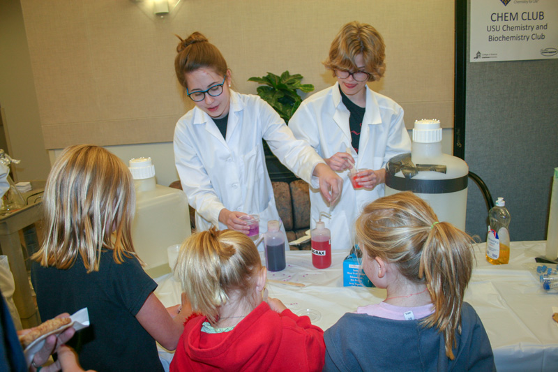 Chemistry club students voluteering at Science Unwrapped